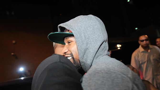 Floyd Mayweather Jr., is greeted by friends and family as he exits the Clark County Detention Center after serving two months of a three-month sentence in a misdemeanor domestic battery case, Friday, Aug. 3, 2012, in Las Vegas. (AP Photo/Isaac Brekken)