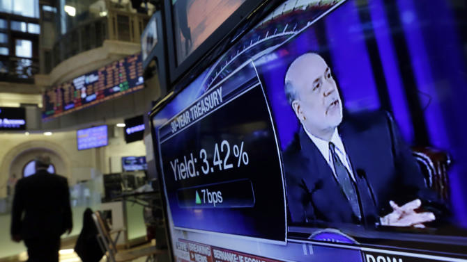Fed Chairman Ben Bernanke's news conference is on a television screen on the floor of the New York Stock Exchange Wednesday, June 19, 2013. The Federal Reserve offered a hint Wednesday that it's moving closer to slowing its bond-buying program, which is intended to keep long-term interest rates at record lows. (AP Photo/Richard Drew)