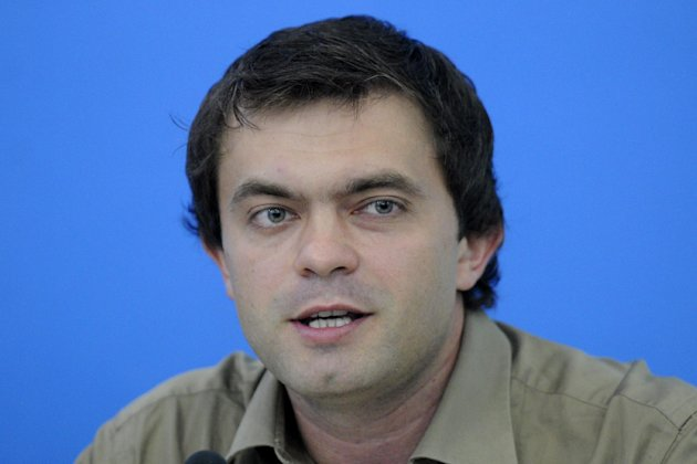 Ruslan Kukharchuk, a journalist who heads the movement &quot;Love against homosexuality&quot; talks to reporters in Kiev, Ukraine, Monday, July 23, 2012. Kukharchuk supports a bill that would ban the &quot;propaganda of homosexuality&quot; . (AP Photo/Sergei Chuzavkov)