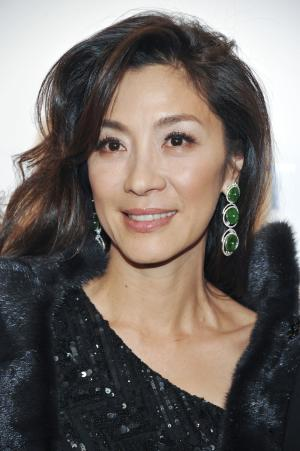 FILE - In this Feb. 9, 2011, file photo, actress Michelle Yeoh attends amfAR's annual New York Gala at Cipriani Wall Street in New York. Officials in Myanmar say the military-backed government has deported Hollywood actress Michelle Yeoh, who stars as pro-democracy leader Aung San Suu Kyi in an upcoming movie. (AP Photo/Evan Agostini, File)