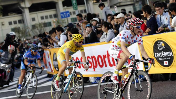 Tinkoff-Saxo team rider Majka of Poland cycles in front of Astana team rider Nibali of Italy during the Tour de France Saitama Criterium cycling race in Saitama
