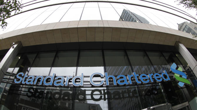 "A sign of Standard Chartered bank is seen at its headquarter in the City of London, Tuesday, Aug. 7, 2012. Shares in Standard Chartered PLC dropped sharply on Tuesday as investors reacted to U.S. charges that the bank was involved in laundering money for Iran. The charges against Standard Chartered were a shock for a bank which proudly described itself recently as ""boring.""  (AP Photo/Sang Tan)"