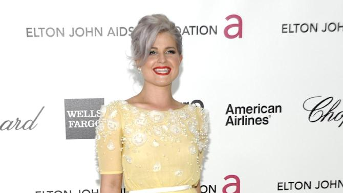 FILE - In this Feb. 26, 2012 file photo, TV personality Kelly Osbourne arrives at the Elton John AIDS Foundation Academy Awards viewing party in West Hollywood, Calif. Gray heads have been popping up on runways and red carpets, on models and young celebrities for months. There's Lady Gaga and Kelly Osbourne _ via dye _ and Hollywood royalty like Oscar-winning British actress Helen Mirren. (AP Photo/Dan Steinberg, file)