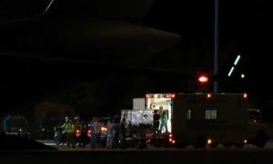 British man infected with Ebola virus is loaded into RAF ambulance after being flown home on a C17 plane from Sierra Leone, at Northolt air base outside London