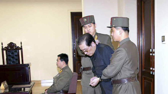 Jang Song Thaek is dragged into the court by uniformed personnel