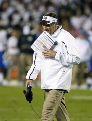 Mississippi State football coach Dan Mullen walks off the field as a time out ends in the first half of their NCAA college football game against Kentucky at Davis Wade Stadium in Starkville, Miss., Thursday, Oct. 24, 2013. (AP Photo/Rogelio V. Solis)