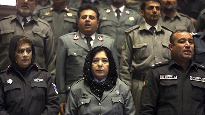 In this picture taken on Sunday, Dec. 21, 2014, Afghanistan's police officers participate in a graduation ceremony in Kabul, Afghanistan. As U.S. and international combat troops leave Afghanistan after more than 13 years fighting the Talban, Afghan policemen are dying in record numbers as they perform dangerous tasks usually reserved for the military, according to the head of the European-funded mission to train the police force. (AP Photo/Rahmat Gul)