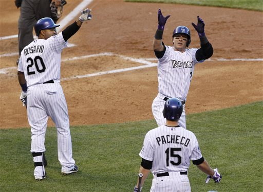 Rosario helps Rockies beat D-backs 5-4 in 10