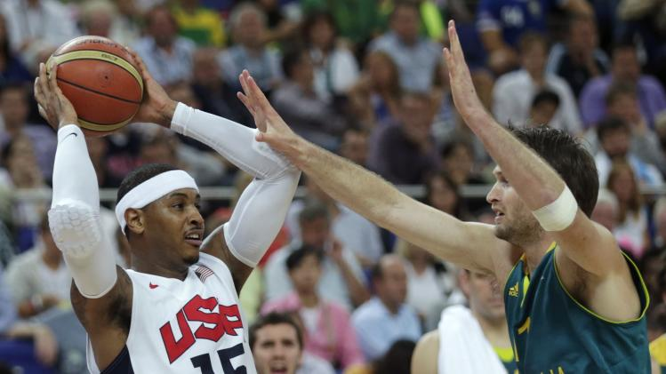 USA's Carmelo Anthony, left, is covered by Australia's Mark Worthington during a men's quarterfinals basketball game at the 2012 Summer Olympics, Wednesday, Aug. 8, 2012, in London. (AP Photo/Charles Krupa)