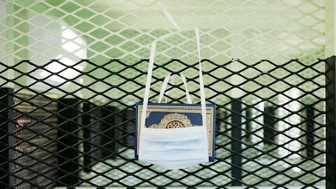 GUANTANAMO BAY, CUBA - MAY 09:  (IMAGE REVIEWED BY U.S. MILITARY PRIOR TO TRANSMISSION)  A Koran hangs in a cell of the Camp 2 cell block at Camp Delta May 9, 2006 in Guantanamo Bay, Cuba. Camp Delta was first occupied on April 28, 2002, when 300 detainees previously held at Camp X-Ray were transferred to Camp Delta. The rest of the detainees were moved on April 29. Camp X-Ray closed down on that same day.  (Photo by Mark Wilson/Getty Images)