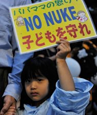 A girl holds up a banner denouncing nuclear power plants during a demonstration in front of the official residence of Japanese Prime Minister Yoshihiko Noda in Tokyo on Friday. Jiji Press news agency estimated the rally, which has been held every Friday since late March, to be around 7000
