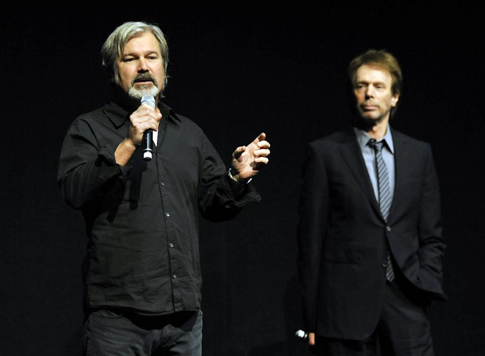 "Gore Verbinski, left, director of the upcoming film ""The Lone Ranger,"" addresses the audience as the film's producer Jerry Bruckheimer looks on during the Walt Disney Studios presentation at CinemaCon 2013 at Caesars Palace on Wednesday, April 17, 2013 in Las Vegas. (Photo by Chris Pizzello/Invision/AP)"