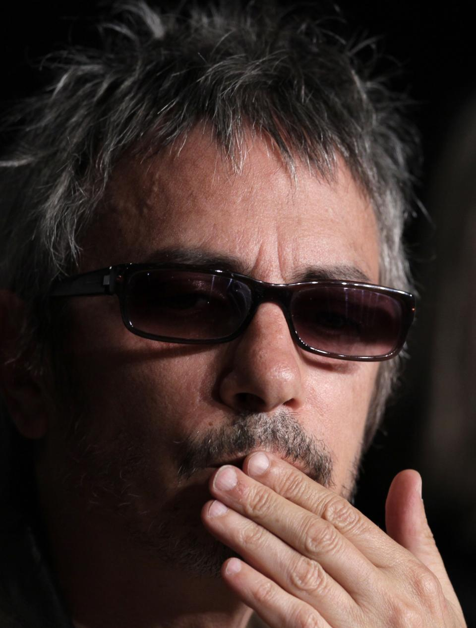 Director Leos Carax gestures during a press conference for Holy Motors at the 65th international film festival, in Cannes, southern France, Wednesday, May 23, 2012. (AP Photo/Francois Mori)