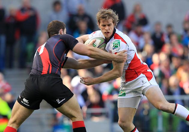 Ulster's Andrew Trimble (R) is tackled by Edinburgh's Tim Visser during the semi-final of the European Rugby match at the Aviva Stadium in Dublin on April 28, 2012. AFP PHOTO / Peter MuhlyPETER MUHLY/