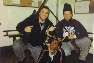 2 white Chicago cops posed for a picture depicting a black detainee as a hunted animal