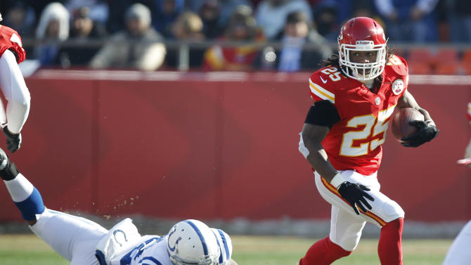 Kansas City Chiefs running back Jamaal Charles (25) runs from Indianapolis Colts outside linebacker Jerry Hughes, left, during the first half of an NFL football game Sunday, Dec. 23, 2012, in Kansas City, Mo. (AP Photo/Ed Zurga)