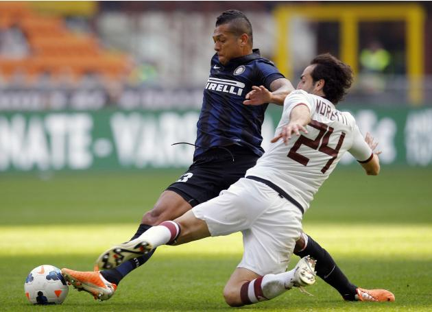 Inter Milan's Guarin fights for the ball with Torino's Moretti during their Italian Serie A soccer match in Milan