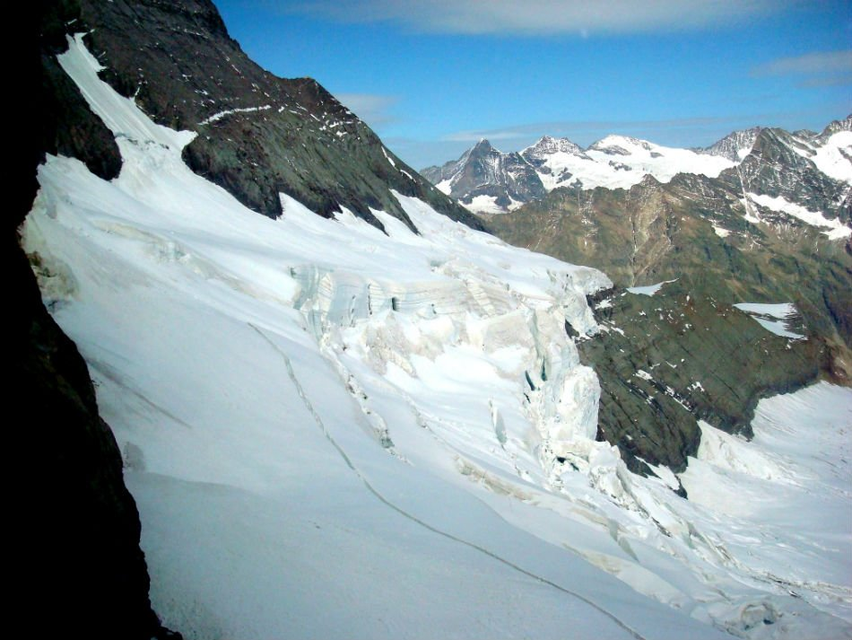 The three mountains on the ridge are Eiger, Mönch and Jungfraujoch