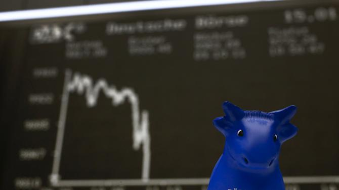 File photo of a bull figurine pictured in front of the German share price index DAX board