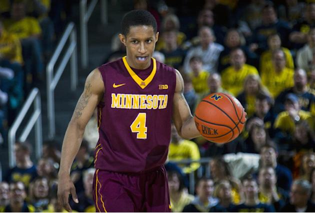 In this March 1, 2014 file photo, Minnesota guard Deandre Mathieu (4) dribbles the ball in the second half of an NCAA college basketball game against Michigan in Ann Arbor, Mich. Minnesota enters the