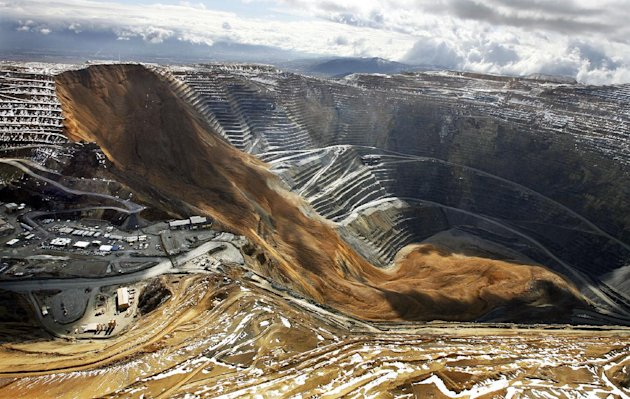 This April 11, 2013, file photo, shows the Kennecott Utah Copper Bingham Canyon Mine after a landslide in Bingham Canyon, Utah. The avalanche near Salt Lake City last year that carried enough rock, dirt and debris to bury New York's Central Park under 66 feet of rubble was North America's largest such disaster in modern history, according to University of Utah scientists. The April 2013 rockslide sent 165 million tons of debris into a nearly mile-deep pit where it cracked bedrock and triggered unprecedented earthquakes, the researchers said in a newly published study. (AP Photo/The Deseret News, Ravell Call, File)