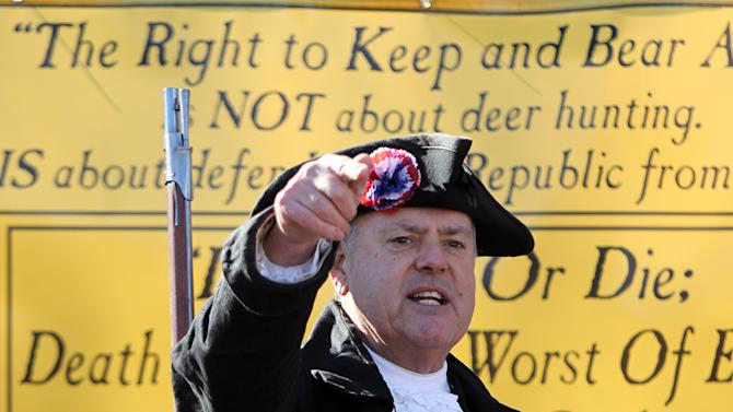Garrett Lear, who calls himself the Patriot Pastyor from Wakefield, N.H. speaks at a rally to promote the right to bear arms in front of the Statehouse in Concord, N.H. Thursday Jan. 31, 2013.  Speakers criticized Democrats in Washington for favoring new gun control laws following the Connecticut school shooting that left 26 dead last month. (AP Photo/Jim Cole)