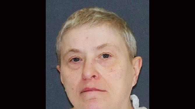 """This handout image provided by the Texas Department of Criminal Justice shows capital murder defendant Suzanne Basso. On Wednesday, Feb 5, 2014 Basso, 59, is scheduled to die for for the torture slaying of Louis """"Buddy"""" Musso, a mentally impaired man near Houston more than 15 years ago.(AP Photo/Texas Department of Criminal Justice)"""