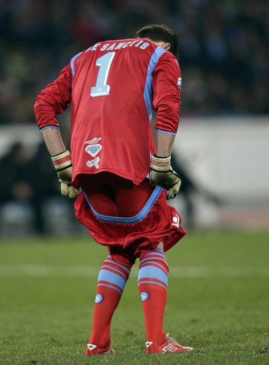 Napoli's goalkeeper De Sanctis adjusts his shorts during their Italian Serie A soccer match against Juventus at the San Paolo Stadium in Naples