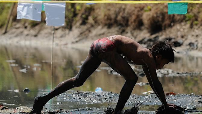 Lekok Villagers Take Part In Traditional Mud Surfing Competition