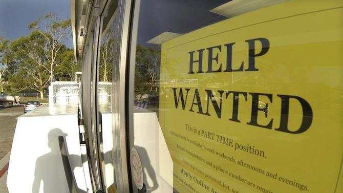 A help wanted sign is posted on the door of a gas station in Encinitas, California