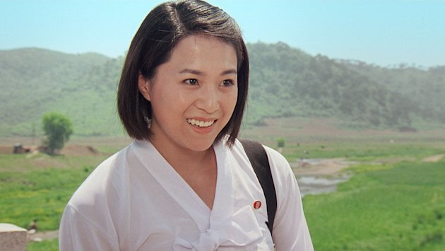"In this image made out of film ""Comrade Kim Goes Flying"" released by Another Dimension of An Idea/Koryo Group, Comrade Kim Yong Mi played by Han Jong Sim smiles in Korean dress. It's a classic tale of a small town girl who follows her dreams to the big city. But in this case, the girl is a North Korean coal miner, the big city is Pyongyang and her dream is to become a high-flying trapeze artist. ""Comrade Kim Goes Flying,"" a collaboration between a North Korean director and two European filmmakers, makes its world premiere Saturday, Sept. 8, 2012 at the Toronto International Film Festival before it heads to Pyongyang later this month for its North Korean debut. (AP Photo/Courtesy of Another Dimension of An Idea/Koryo Group) EDITORIAL USE ONLY"