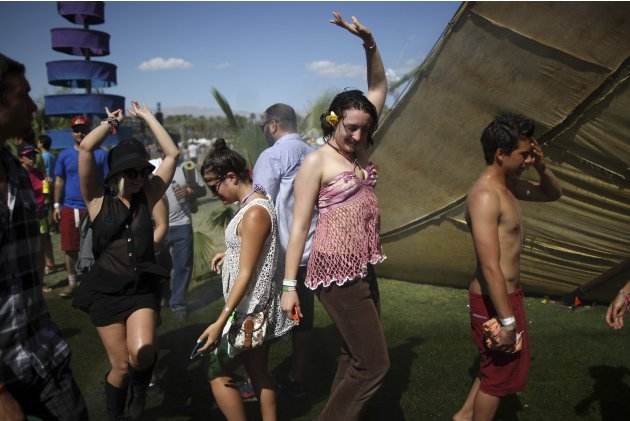People dance on the final day of the Coachella Valley Music and Arts Festival in Indio