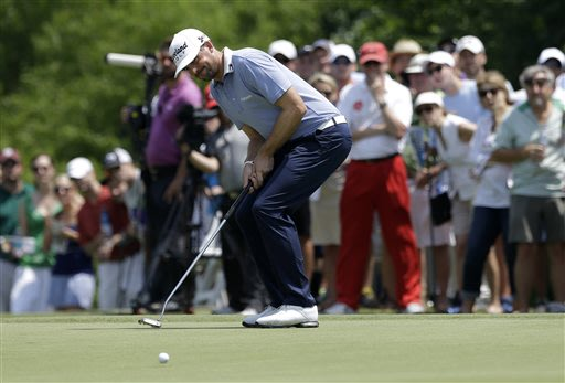 Keegan Bradley reacts to missing a putt for birdie on the second green during the third round of the Byron Nelson Championship golf tournament Saturday, May 18, 2013, in Irving, Texas. Bradley hit for