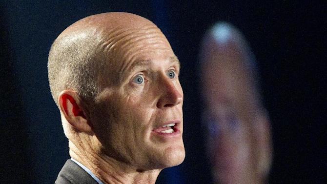 "FILE - In this May 16, 2012 file photo, Florida Gov. Rick Scott speaks in Fort Lauderdale. Florida Gov. Rick Scott, long opposed President Barack Obama's remake of the health insurance market. After President Obama won re-election, the Republican governor softened his tone. He said he wanted to ""have a conversation"" with the administration about implementing the 2010 law.   (AP Photo/J Pat Carter, File)"