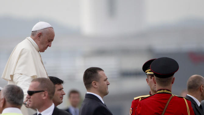 Pope Francis arrives at Tirana's Mother Teresa international airport, Sunday, Sept. 21, 2014. Pope Francis is here for a one-day visit during which he will attend a meeting with representatives of different religions. (AP Photo/Alessandra Tarantino)