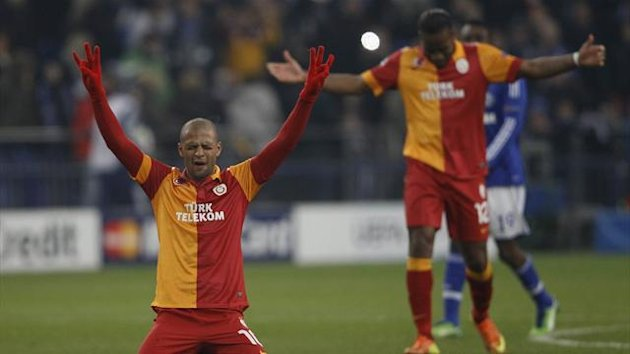 Galatasaray's Didier Drogba (R) and Felipe Melo celebrate their victory over Schalke 04 following their Champions League soccer match in Gelsenkirchen March 12, 2013.
