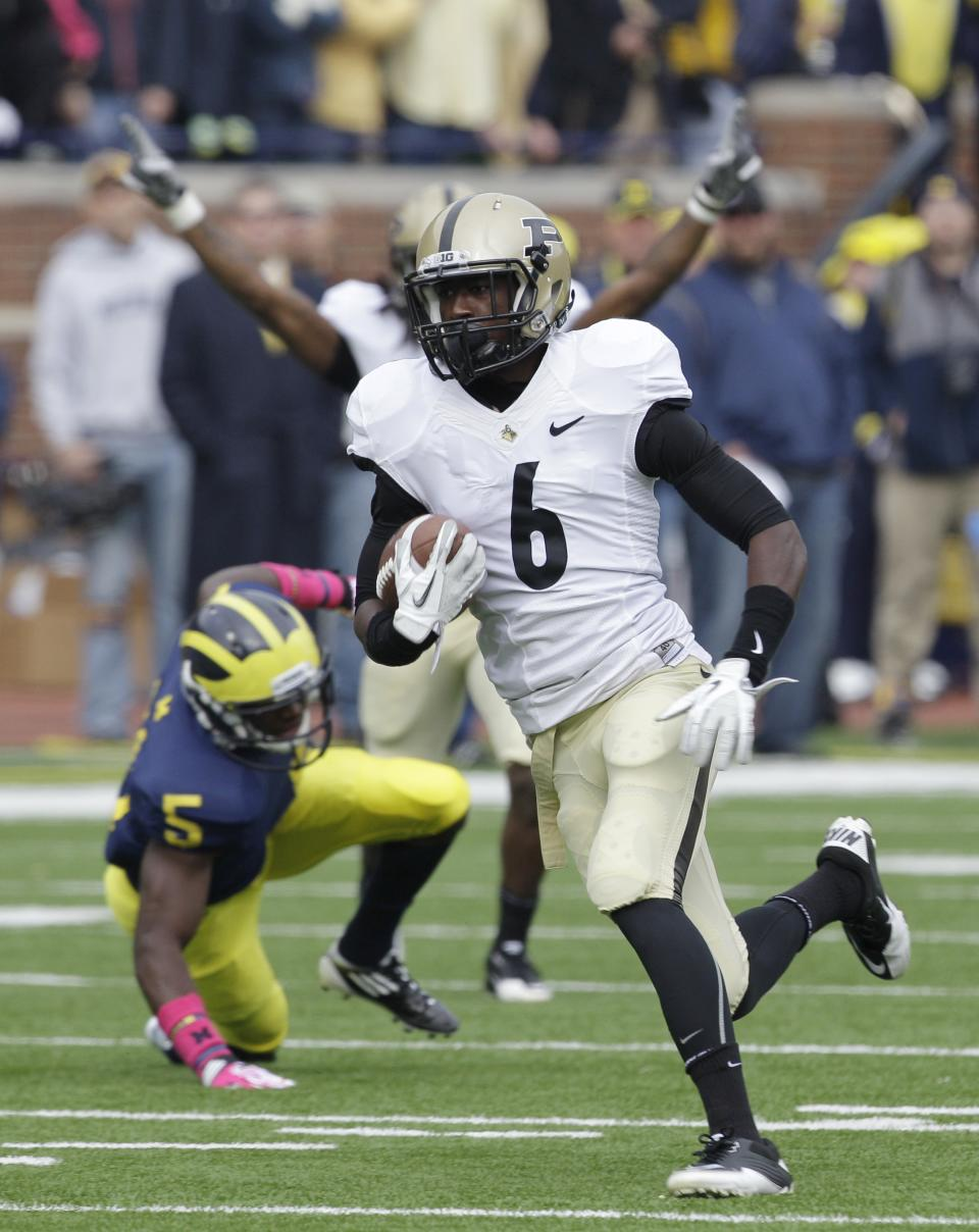 Purdue wide receiver Gary Bush (6) runs for a touchdown during the first quarter of an NCAA college football game against Michigan in Ann Arbor, Mich., Saturday, Oct. 29, 2011. (AP Photo/Carlos Osorio)