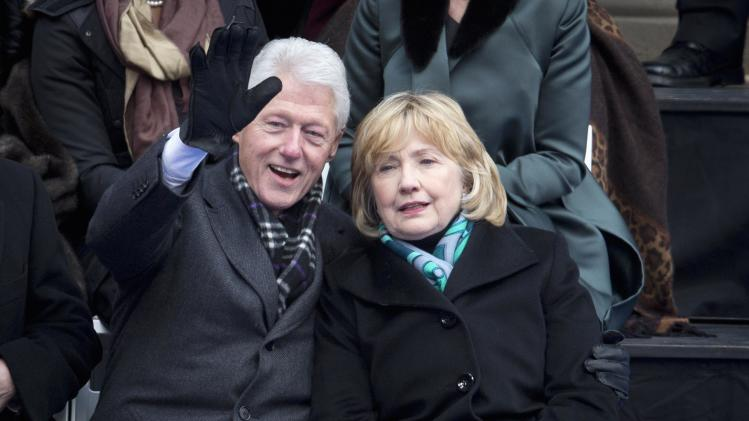 Former President Bill Clinton and wife Hillary at De Blasio's inauguration in City Hall, New York