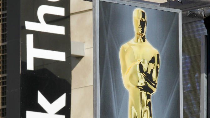An Oscar banner is displayed outside the Kodak Theatre as preparations for the 84th Academy Awards continue in Los Angeles on Friday,  Feb. 24, 2012. The Oscars will be held on Sunday. (AP Photo/Amy Sancetta)