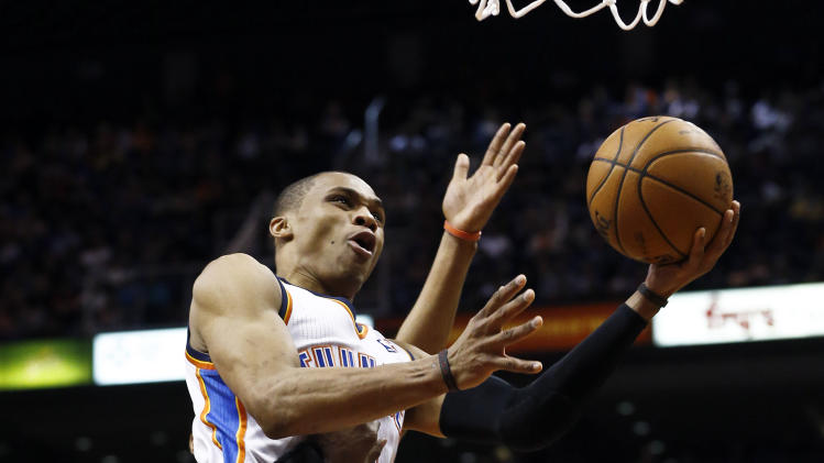 Oklahoma City Thunder's Russell Westbrook, top, gets fouled by Phoenix Suns' Jermaine O'Neal (20) as he goes up for a shot during the first half in an NBA basketball game Sunday, Feb. 10, 2013, in Phoenix.(AP Photo/Ross D. Franklin)