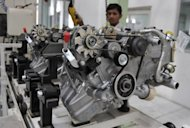 Indian workers assemble a mini-truck at a plant in Chakan, south-east of Mumbai, 2010. India's factory sector activity in July grew at its most sluggish pace for eight months, a survey showed Wednesday, underlining the weakening state of Asia's third-largest economy