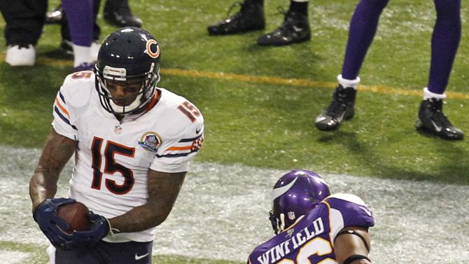Chicago Bears wide receiver Brandon Marshall (15) makes a reception over Minnesota Vikings cornerback Antoine Winfield (26) during the second half of an NFL football game Sunday, Dec. 9, 2012, in Minneapolis. (AP Photo/Genevieve Ross)