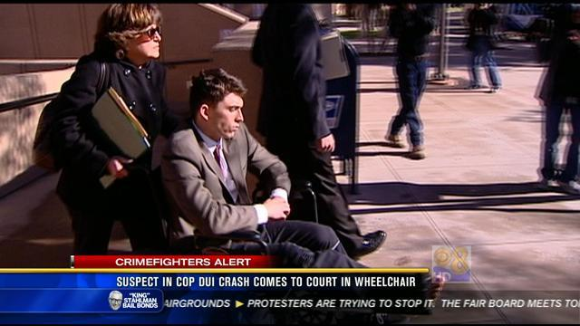 Suspect in cop DUI crash comes to court in wheelchair