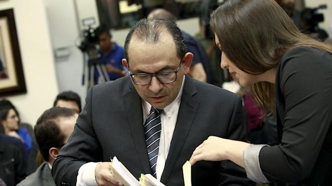 Lawyers Marvin Carvajal and Viviana Benavides check folders before a hearing convened by the Inter-American Commission on Human Rights (IACHR) to monitor the government's compliance with the ruling lifting the country's ban on in-vitro