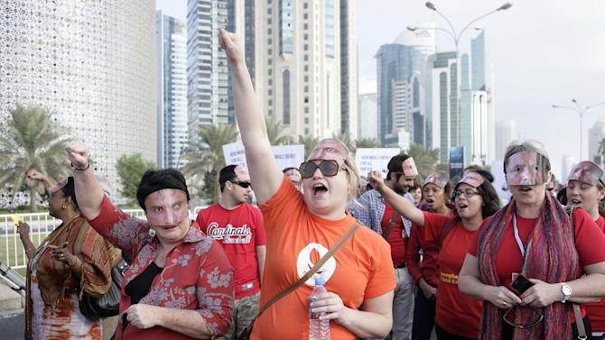 Local and international activists march to demand urgent action to address climate change at the U.N. climate talks in Doha, Qatar, Saturday , Dec. 1, 2012. (AP Photo/Osama Faisal)