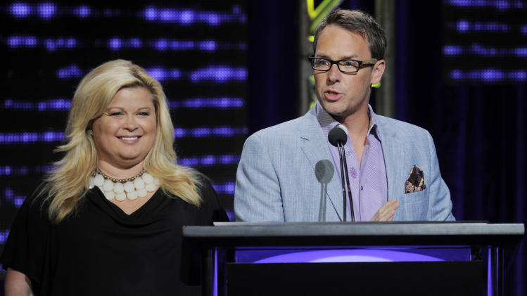 FILE - This Aug. 2, 2012 file photo shows Sheri Salata, left, and Erik Logan, co-presidents of OWN addressing reporters during the network's Summer 2012 TCA Presentation at the Beverly Hilton in Beverly Hills, Calif. The upcoming Lindsay Lohan series on OWN will be more documentary than reality show. Logan and Salata told journalists attending the annual Television Critics Association press tour on Thursday, July 25, 2013, that filmmaker Amy Rice will direct the series. (Photo by Chris Pizzello/Invision/AP, File)