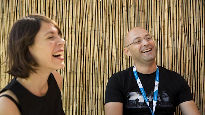 Directors Tal Granit, left, and Sharon Maymon laugh during an interview with The Associated Press for their film The Farewell Party, during the 71st edition of the Venice Film Festival in Venice, Italy, Thursday, Aug. 28, 2014. (AP Photo/David Azia)