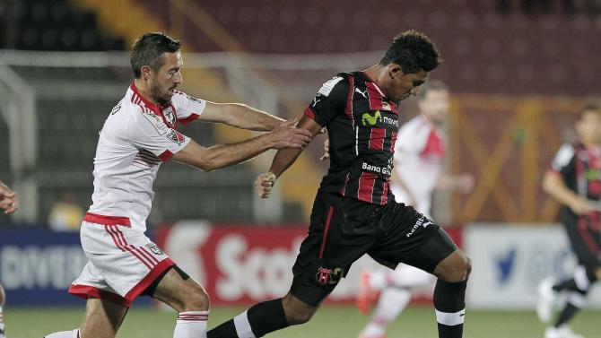 Davy Arnaud of of D.C. United of the U.S fights for the ball with Jose Ortiz of Costa Rica's Liga Deportiva Alajuelense during their CONCACAF Champions League soccer match  in Alajuela
