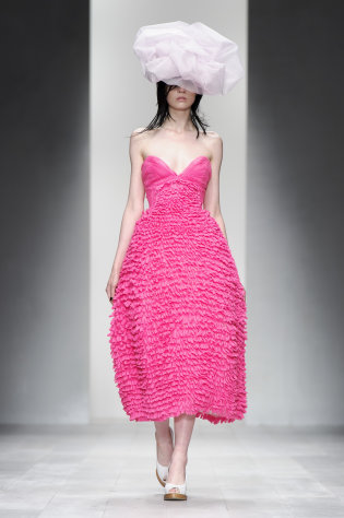A model wears a design from the John Rocha Spring/Summer 2013 collection during London Fashion Week, Saturday, Sept. 15, 2012. (AP Photo/Jonathan Short)