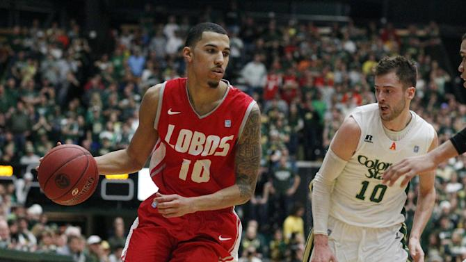 New Mexico guard Kendall Williams, left, drives for a basket past Colorado State guad Wes Eikmeier in the second half of New Mexico's 91-82 victory in an NCAA basketball game in Fort Collins, Colo., on Saturday, Feb. 23, 2013. Williams scored 46 points in the game. (AP Photo/David Zalubowski)